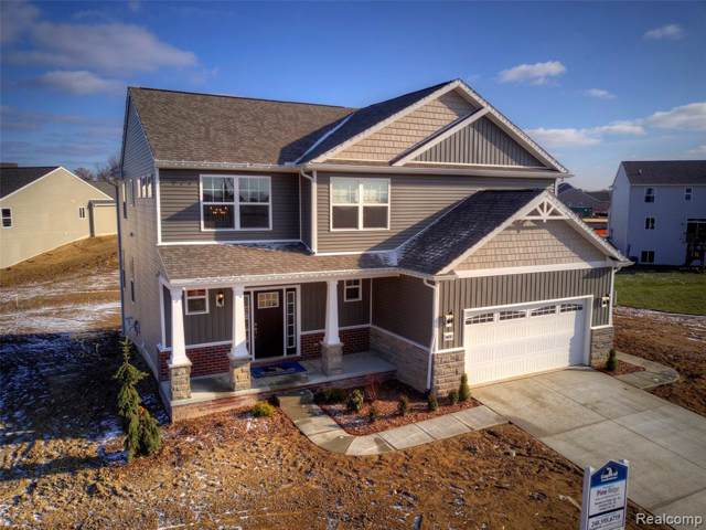 7635 Bent Grass Trail, Oceola Twp, MI 48843 (#219105311) :: The Mulvihill Group
