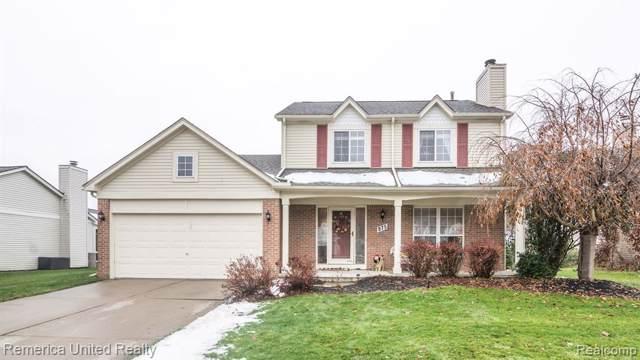 975 Oak Creek Drive, South Lyon, MI 48178 (#219114343) :: The Buckley Jolley Real Estate Team