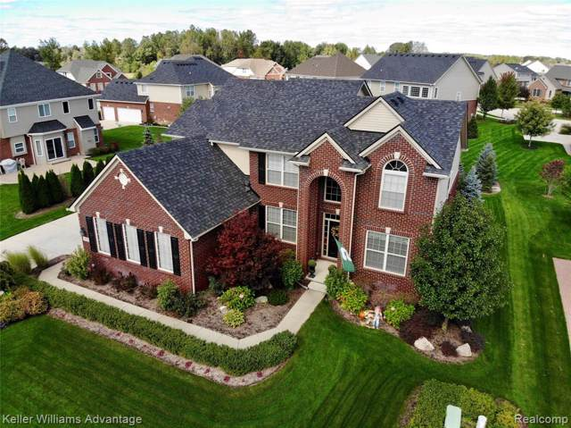 54868 Brentwood Drive, Lyon Twp, MI 48178 (MLS #219115553) :: The Toth Team