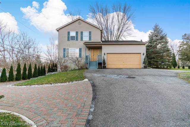 1291 Sleeth Road, Commerce Twp, MI 48382 (#2200004912) :: The Mulvihill Group