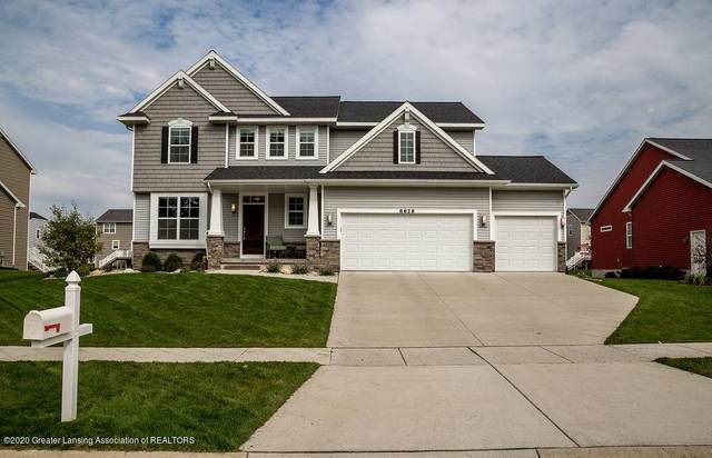 8628 Carlsbad Lane, Delta Twp, MI 48917 (#630000244404) :: Alan Brown Group