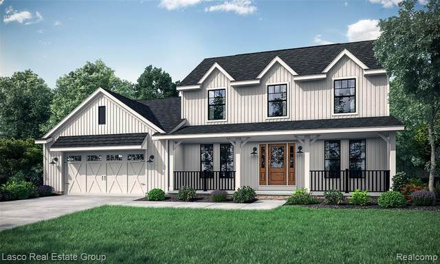 16142 Catalpa Ridge Drive, Holly Twp, MI 48442 (MLS #2200019939) :: The John Wentworth Group