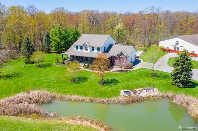 6777 Spring Meadow Lane, Salem Twp, MI 48170 (#2200033553) :: The Mulvihill Group