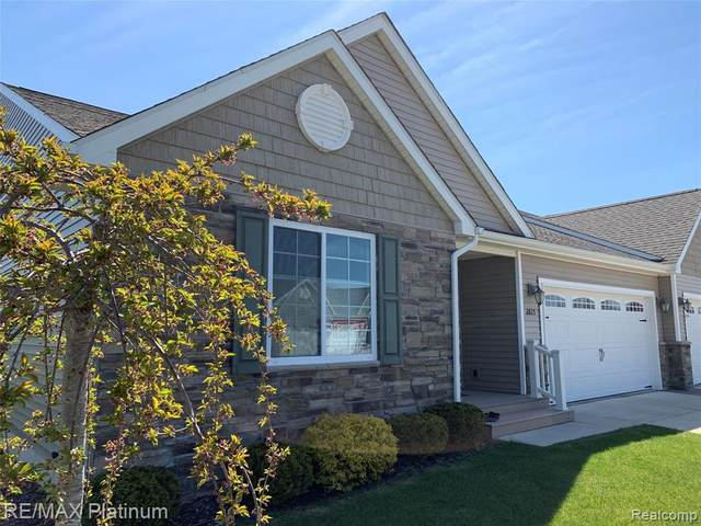 2825 Grand Marais Drive #15, Oceola Twp, MI 48843 (MLS #2200037875) :: The John Wentworth Group