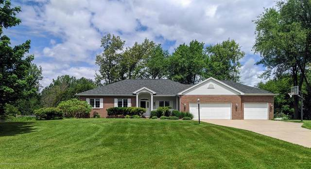 5336 Hilltop Trail, Perry Twp, MI 48872 (MLS #630000246416) :: The Toth Team