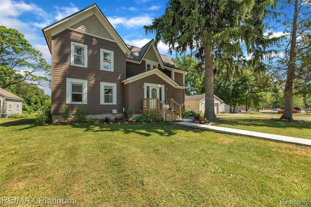705 E. Maple Street, Holly Vlg, MI 48422 (MLS #2200051373) :: The John Wentworth Group