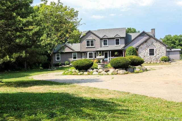 5665 Sutton Road, Attica Twp, MI 48428 (MLS #2200051936) :: The John Wentworth Group