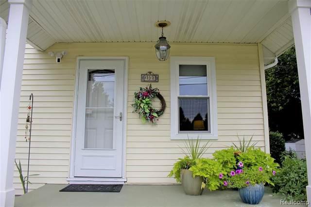 2121 Joy Road, Auburn Hills, MI 48326 (MLS #2200052641) :: The John Wentworth Group