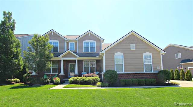 1793 Carriage Hill, Commerce Twp, MI 48382 (MLS #2200054104) :: The John Wentworth Group