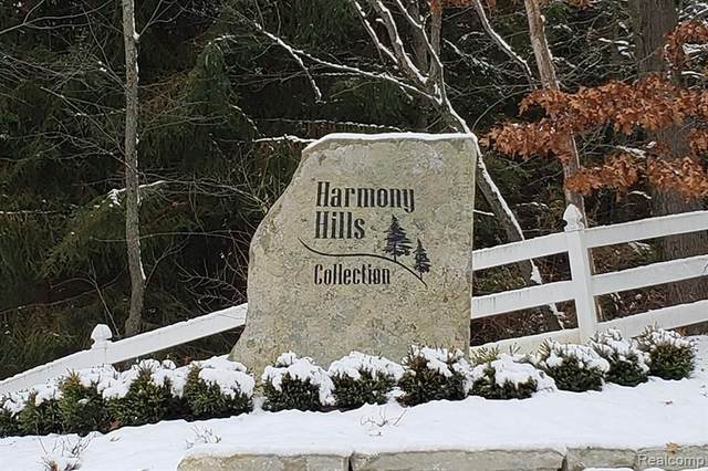 721 Harmony Hills Parkway, Oxford Twp, MI 48371 (#2200054678) :: The Mulvihill Group