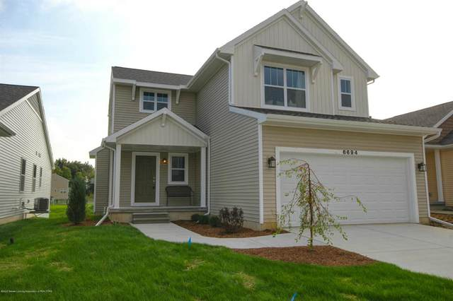6694 Cotswald Drive, Delta Twp, MI 48837 (#630000248564) :: The BK Agency