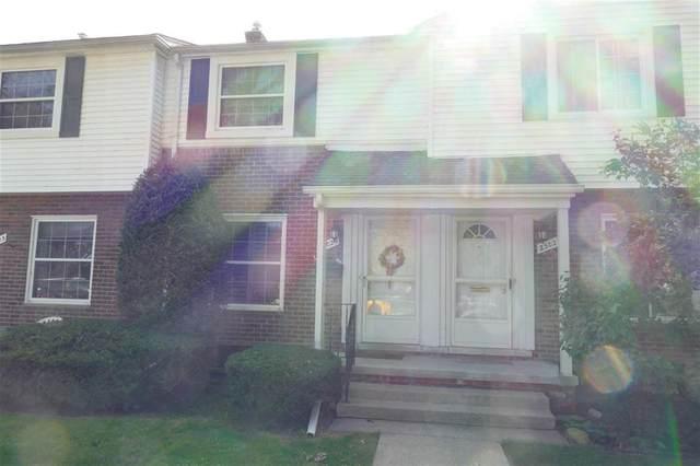 23025 Gary Lane Unit 204, Saint Clair Shores, MI 48080 (#58050023948) :: Duneske Real Estate Advisors