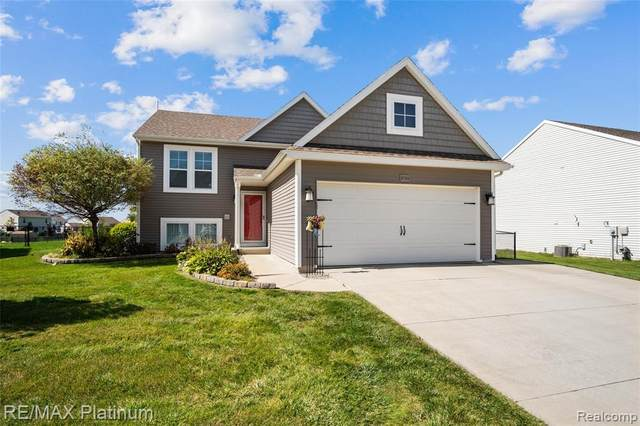 3735 Amber Oaks Drive, Howell Twp, MI 48855 (#2200077311) :: Novak & Associates