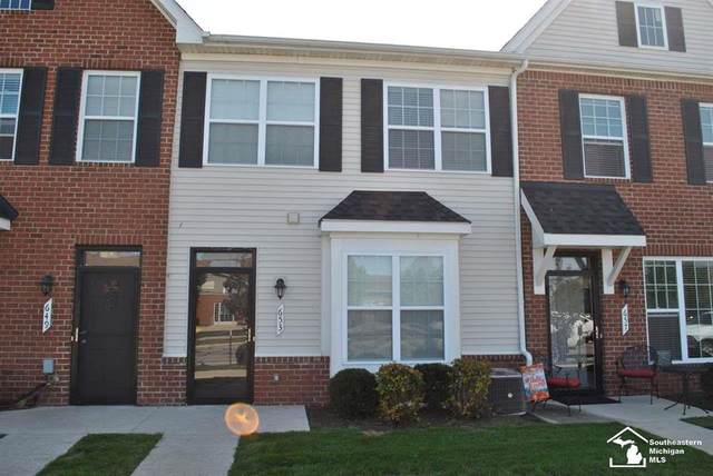 653 Powell, Dundee, MI 48131 (MLS #57050024344) :: The John Wentworth Group