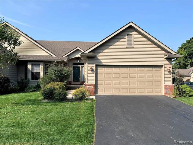 6050 Green Ash Drive #35, Brighton, MI 48116 (MLS #2200079200) :: The John Wentworth Group