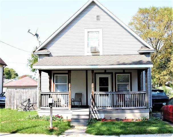 135 N Carolina Street, Saginaw, MI 48602 (#2200081627) :: The Merrie Johnson Team