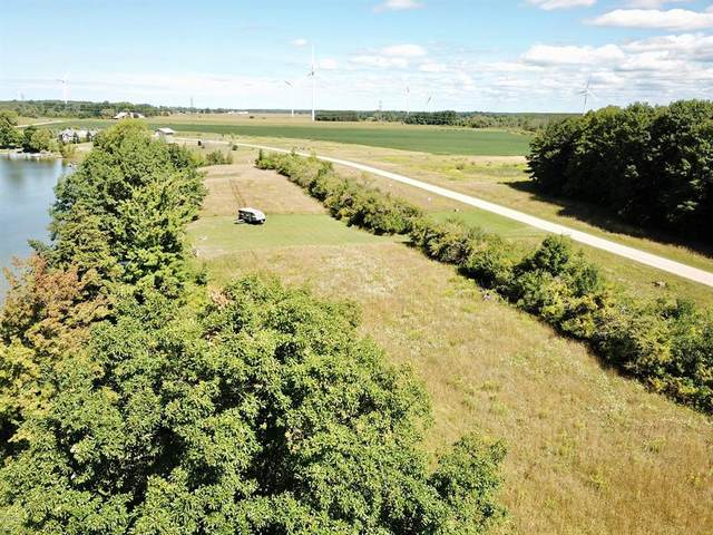 2 Waters Edge Drive, Riverton Twp, MI 49454 (#67020006640) :: Real Estate For A CAUSE