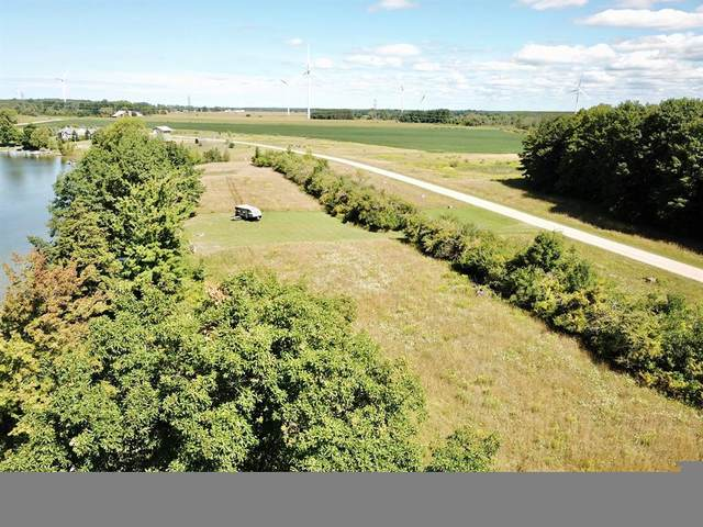 8 Waters Edge Drive, Riverton Twp, MI 49454 (#67020006653) :: Real Estate For A CAUSE