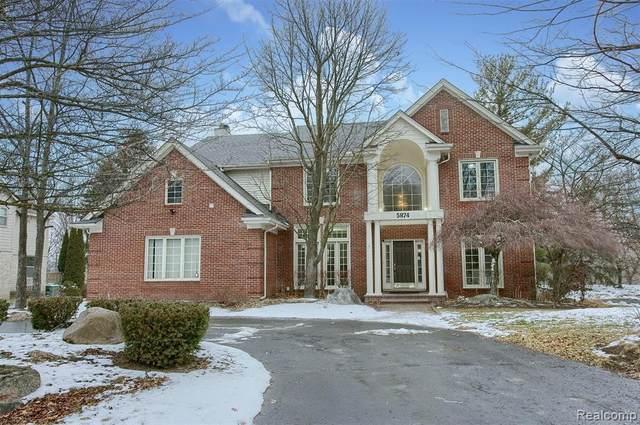 5874 Orchard Woods Drive, West Bloomfield Twp, MI 48324 (#2210001982) :: Novak & Associates