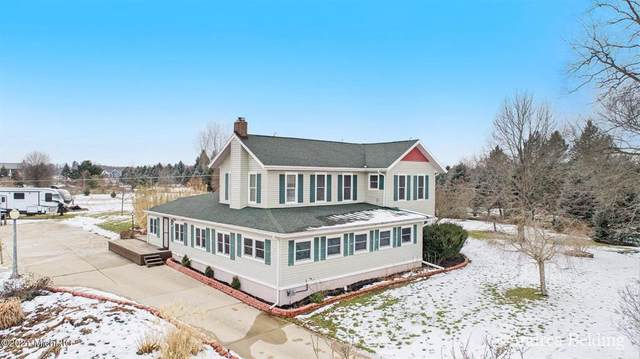 8303 Corrison Rd, Out Of Area, MI 48837 (#59021001430) :: The Mulvihill Group