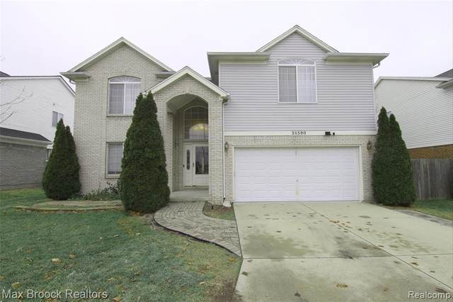 38590 Rougewood Drive, Sterling Heights, MI 48312 (MLS #2210004895) :: The John Wentworth Group
