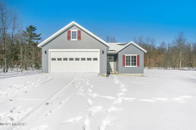 5070 Andrea Drive, Fruitland Twp, MI 49445 (#71021005051) :: The Mulvihill Group
