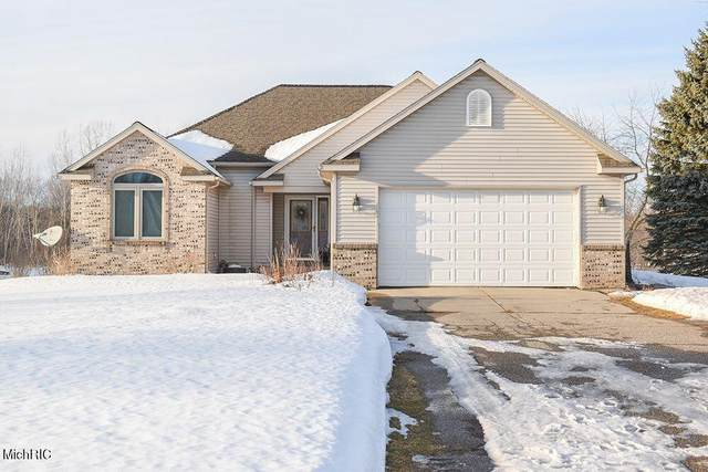 6505 Foxtail Meadows Drive NE, Courtland Twp, MI 49341 (#65021005560) :: The Alex Nugent Team | Real Estate One