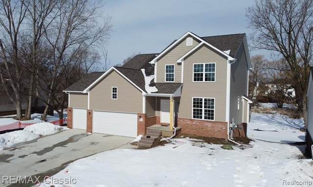 1840 Crimson Ridge, Commerce Twp, MI 48390 (MLS #2210012812) :: The John Wentworth Group