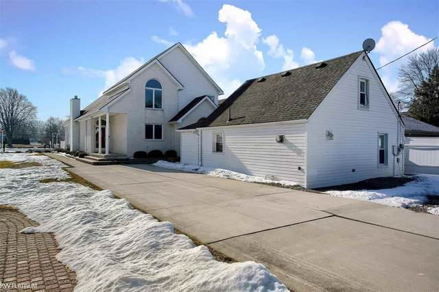 29442 Old North River Rd, Harrison Twp, MI 48045 (MLS #58050035125) :: The John Wentworth Group