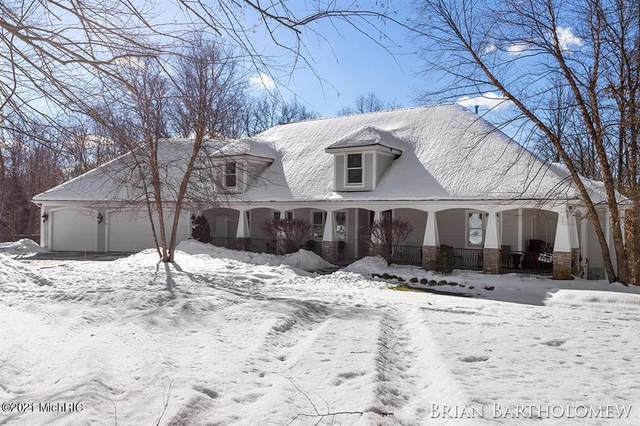 7125 Tramore Court NE, Cannon Twp, MI 49306 (#65021005962) :: The Alex Nugent Team | Real Estate One