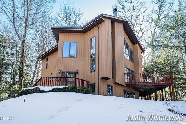 7403 N Old Channel Trail, White River Twp, MI 49437 (#65021006227) :: The Mulvihill Group