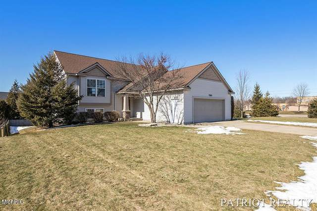 7581 Hide Away Drive, Georgetown Twp, MI 49426 (#65021006335) :: The Merrie Johnson Team