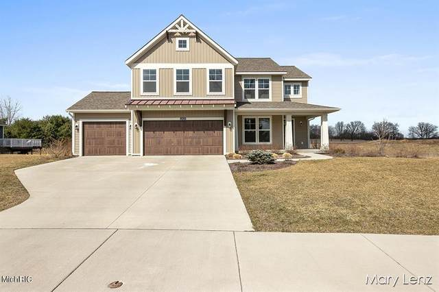 12025 Harvest Home Drive, Vergennes Twp, MI 49331 (#65021009377) :: Robert E Smith Realty