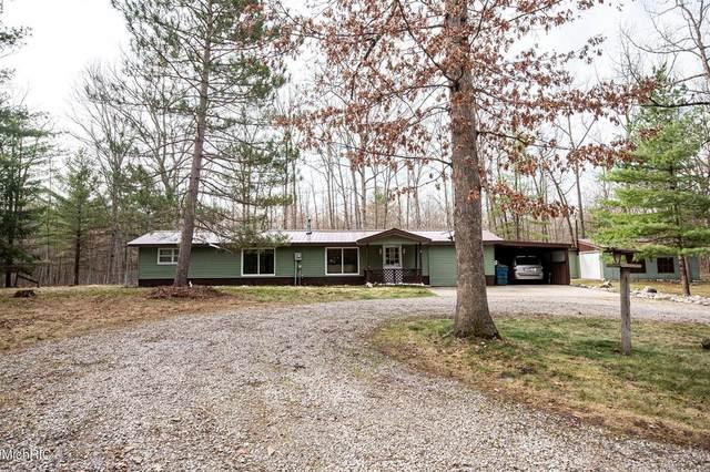 8758 N Bass Lake Road, Elk Twp, MI 49644 (#67021011051) :: The Alex Nugent Team | Real Estate One