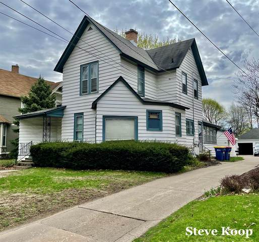 456 Crescent Street NE, Grand Rapids, MI 49503 (#65021011720) :: The BK Agency
