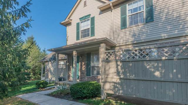 125 Commons Circle, Saline, MI 48176 (MLS #543279991) :: The John Wentworth Group