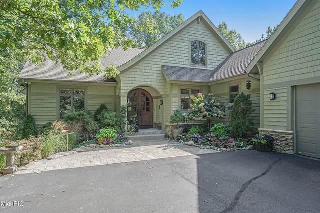 9100 Twin Oaks Lane NE, Ada Twp, MI 49301 (#65021011929) :: GK Real Estate Team
