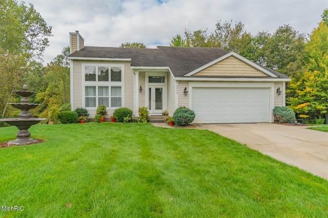 5743 Grand Oaks Drive NE, PLAINFIELD TWP, MI 49321 (#71021012613) :: GK Real Estate Team