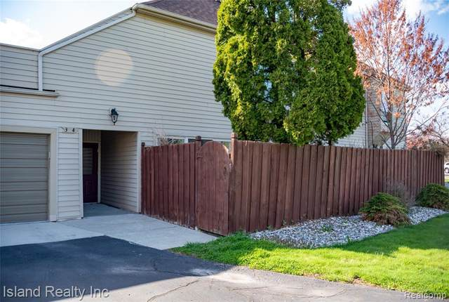 8309 Colony Dr Apt 4, Grosse Ile Twp, MI 48138 (#2210026735) :: Real Estate For A CAUSE