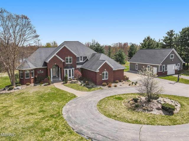 8890 Vincent Avenue SE, Caledonia Twp, MI 49302 (#65021013602) :: Real Estate For A CAUSE