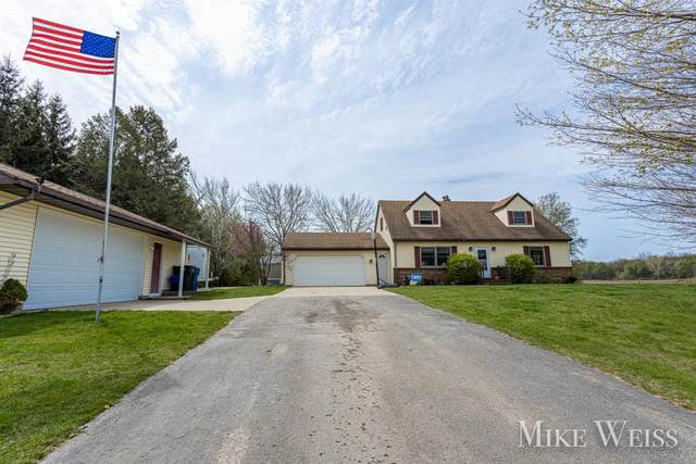 6186 100th Street SE, Caledonia Twp, MI 49316 (#65021014640) :: Real Estate For A CAUSE