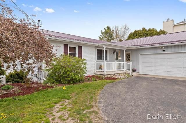 8361 Bay Drive NE, Grattan Twp, MI 49341 (#65021015036) :: Real Estate For A CAUSE