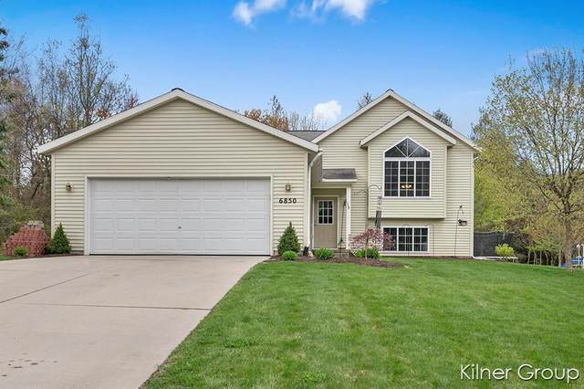 6850 Whispering Forest Drive NE, Nelson Twp, MI 49319 (#65021015225) :: Real Estate For A CAUSE