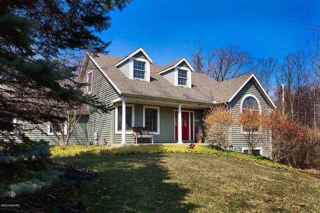 737 Wilderness Ridge Drive, DOUGLAS VLLG, MI 49406 (#71021015423) :: Real Estate For A CAUSE