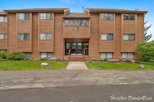 6731 Boca Vista Drive NE #302, Cannon Twp, MI 49341 (#65021015550) :: Real Estate For A CAUSE