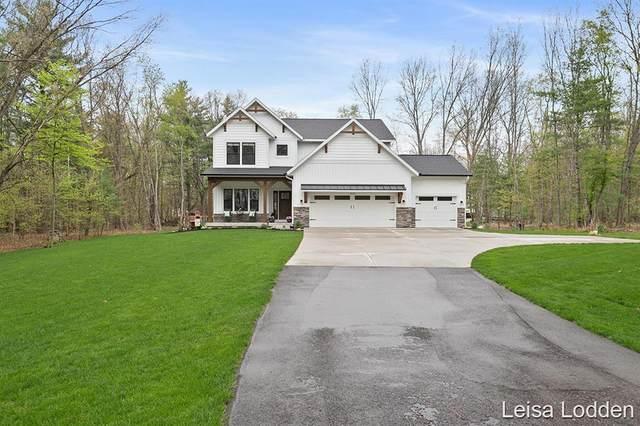 8100 Copper Ridge Drive NE, Cannon Twp, MI 49341 (#65021015695) :: Real Estate For A CAUSE