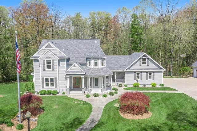 18779 N Fruitport Road, Spring Lake Twp, MI 49456 (#71021015854) :: Real Estate For A CAUSE