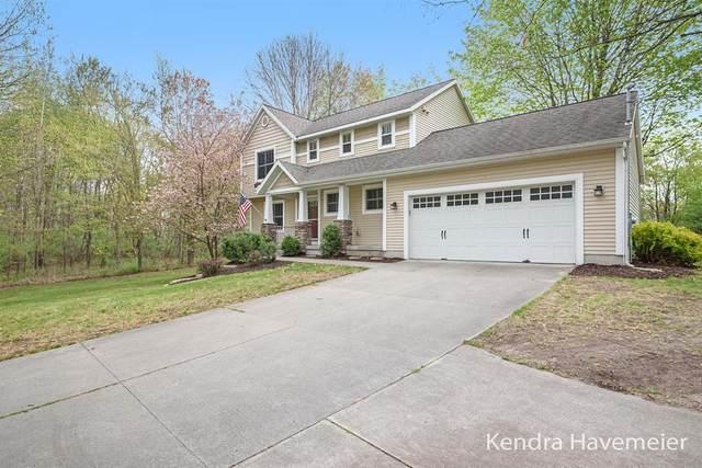 9122 Elstner Avenue NE, Algoma Twp, MI 49341 (#65021016400) :: Real Estate For A CAUSE