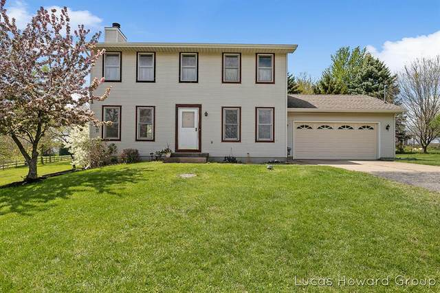 7711 Ramsdell Drive NE, Cannon Twp, MI 49341 (#65021016607) :: Real Estate For A CAUSE
