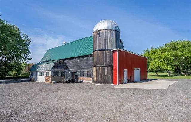 6151 Pine Knob Rd, Clarkston, MI 48348 (#58050043571) :: Real Estate For A CAUSE
